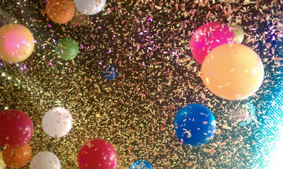 image of balloons and confetti